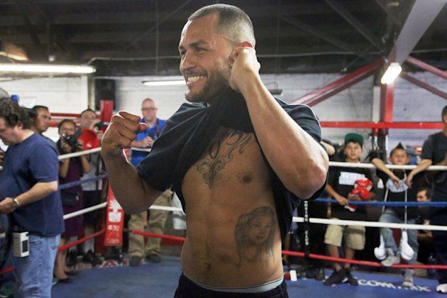 Mike Alvarado poses in the ring during a workout in front of the media in Bell, Calif., Wednesday, May 14, 2014. He and Juan Manuel Marquez, of Mexico, are preparing for their WBO welterweight elimination bout at the Forum in Inglewood, Calif., Saturday. The winner will become the mandatory challenger to WBO welterweight champion Manny Pacquiao. (AP Photo/Nick Ut)