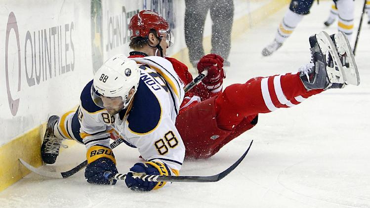 Buffalo Sabres' Cory Conacher (88) is taken down by Carolina Hurricanes' Alexander Semin, of Russia, during the first period of an NHL hockey game in Raleigh, N.C., Thursday, March 13, 2014. (AP Photo/Karl B DeBlaker)