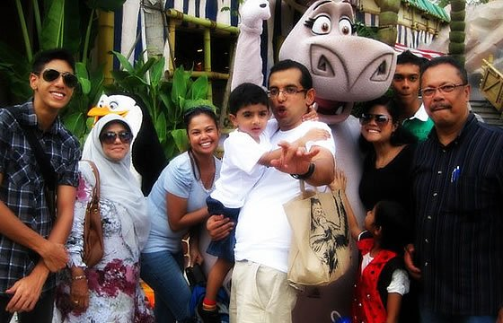 Mohamed Isaac with his foster family at a recent outing. (Photo by Nadiah Md Ali)