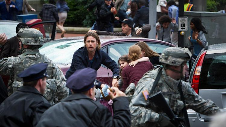 "This publicity photo released by Paramount Pictures shows, center, Brad Pitt as Gerald Lane in a scene from the film, ""World War Z,"" from Paramount Pictures and Skydance Productions in association with Hemisphere Media Capital and GK Films. (AP Photo/Paramount Pictures, Jaap Buitendijk)"