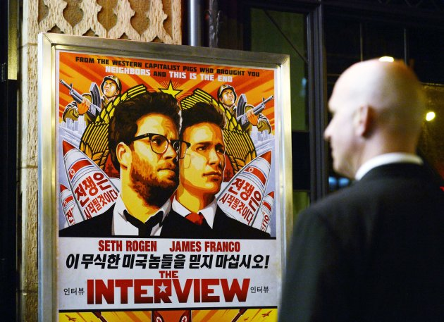 A security guard stands at the entrance of a theater during the premiere of 'The Interview.' (Reuters)