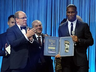 HRH Prince Albert II of Monaco (L) and Didider Drogba attend the Golden Foot Award 2013 ceremony at Monte-Carlo Bay Hotel