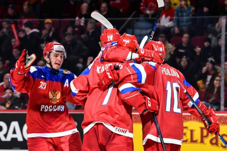 Russian players celebrate during the bronze medal game at the world junior championships in Montreal. (Photo by Minas Panagiotakis/Getty Images)