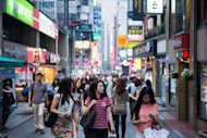 This file photo shows people walking in a street of central Seoul, in June. South Korea's capital stands to lose one million people of working age over the next 20 years -- a fallout from the country's status as one of the world's most rapidly ageing societies