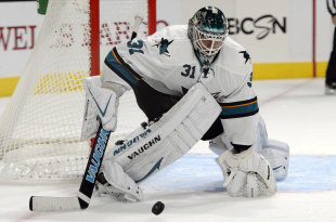 Oct 8, 2014; Los Angeles, CA, USA; San Jose Sharks goalie Antti Niemi (31) protects the goal as the puck passes against the Los Angeles Kings during the third period at Staples Center. The San Jose Sharks defeated the Los Angeles Kings 4-0. (Kelvin Kuo-USA TODAY Sports)