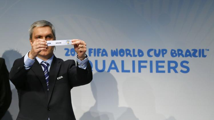 Savic head of FIFA World Cup Qualifiers displays name of Ukraine during draw for 2014 World Cup European qualifying playoffs in Zurich