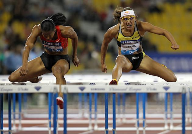 Virginia Powell-Crawford (L) and Lolo Jones of the US compete in the women's 100m hurdles at the IAAF Diamond League in Doha on May 6, 2011. AFP PHOTO/KARIM JAAFAR (Photo credit should read KARIM