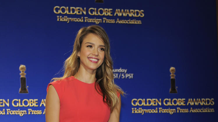 Actress Jessica Alba poses for photographers after helping to announce nominations for the 70th Annual Golden Globe Awards, Thursday, Dec. 13, 2012, in Beverly Hills, Calif. The Golden Globe Awards will be held on Sunday, Jan. 13 at the Beverly Hilton Hotel in Beverly Hills. (Photo by Chris Pizzello/Invision/AP)