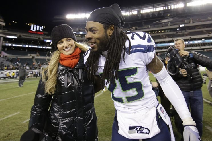 Erin Andrews with Seahawks cornerback Richard Sherman after a 2014 game. (AP)