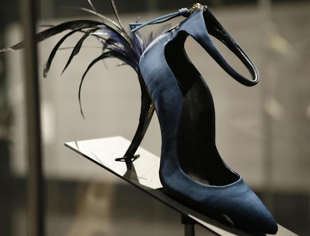 "This Feb. 11, 2013 photo shows Roger Vivier's Eyelash Heel pump displayed at the ""Shoe Obsession"" exhibit at The Museum at the Fashion Institute of Technology Museum in New York. The exhibition, showi"