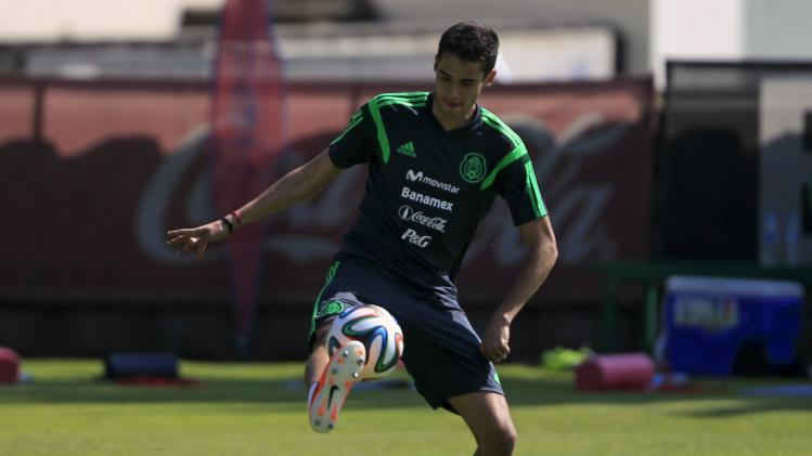 Reyes kicks the ball during a practice session in Mexico City