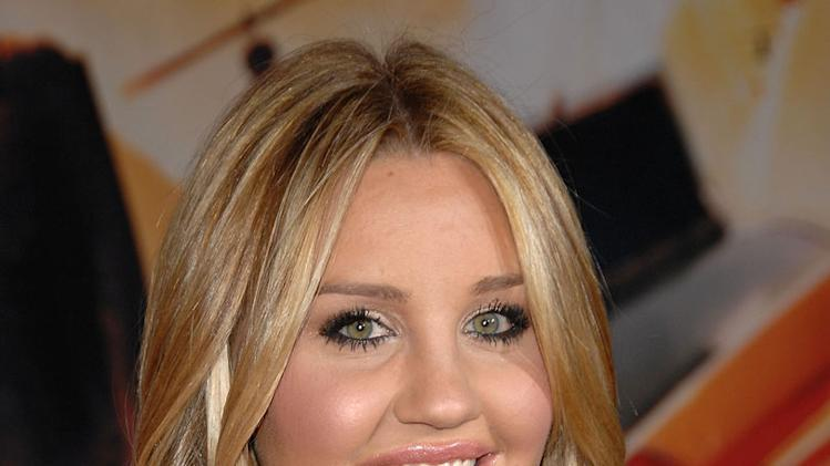 "Amanda Bynes arrives on the red carpet of the Los Angeles premiere of ""Race To Witch Mountain"" at the El Capitan Theatre on March 11, 2009 in Hollywood, California."