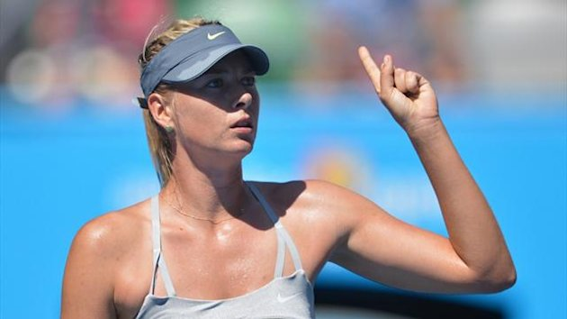 Russia's Maria Sharapova gestures during her match against Belgium's Kirsten Flipkins at the Australian Open (AFP)