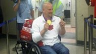 Dave Durepos showed off his third gold medal on Monday night when he arrived at the Fredericton Airport. Durepos and his men's wheelchair basketball team defeated Australia on Saturday.