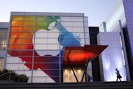 An Apple logo is seen on a building in San Francisco March 6, 2012. Apple scheduled an announcement Monday on plans for its huge cash balance, estimated to be at least $97 billion from sales of its hugely successful gadgets like the iPad and iPhone