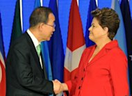 UN Secretary General Ban Ki-Moon (L) shakes hands with Brazil's President Dilma Rousseff, during the UN Conference on Sustainable Development Rio+20 opening ceremony at RioCentro, in Rio de Janeiro, Brazil
