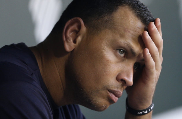 FILE - In this Sept. 11, 2013, file photo, New York Yankees' Alex Rodriguez wipes sweat from his brow as he sits in the dugout before a baseball game against the Baltimore Orioles in Baltimore. The U.S. government says New York Yankees star Alex Rodriguez paid his cousin almost $1 million to keep secret Rodriguez's use of performance enhancing drugs. In court documents filed last week in Miami, federal prosecutors say Rodriguez paid $900,000 last year to settle a threatened lawsuit by Yuri Sucart, who had worked as Rodriguez's personal assistant. Sucart, in a letter from his lawyer, threatened to expose Rodriquez's PED use if he wasn't paid $5 million. (AP Photo/Patrick Semansky, File)