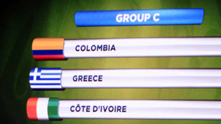 The teams in Group C for the 2014 World Cup finals are shown on the screen after the draw was made at the Costa do Sauipe resort in Sao Joao da Mata