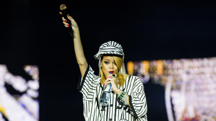 Rihanna plays at the Roskilde Festival in Roskilde, Denmark, Friday night, July 5, 2013. Roskilde Festival is the largest North European culture and music festival and has existed since 1971. (AP Photo/Simon Fals, Polfoto ) DENMARK OUT