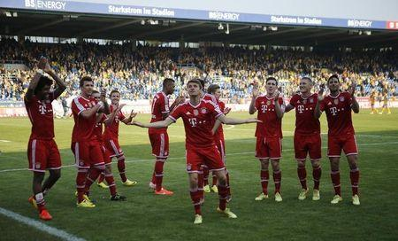 Bayern Munich players celebrate after Bundesliga soccer match against Eintracht Braunschweig in Berlin