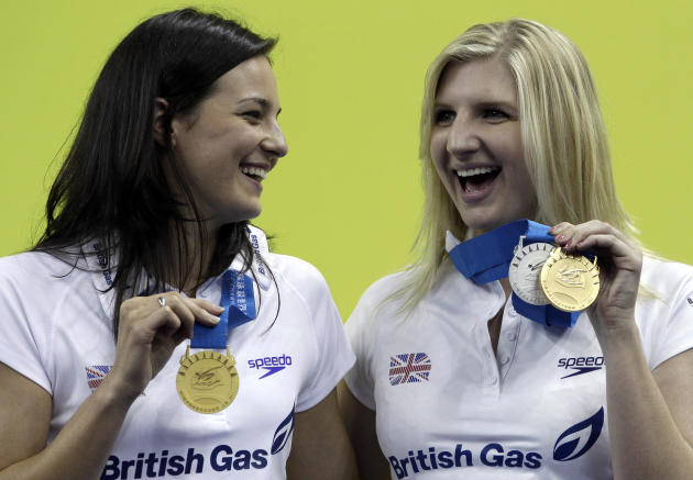 Britain's Keri-Anne Payne, left, and Rebecca Adlington show their medals at the FINA Swimming World Championships in Shanghai, China, Sunday, July 31, 2011. Payne won the gold in the 10km open wat
