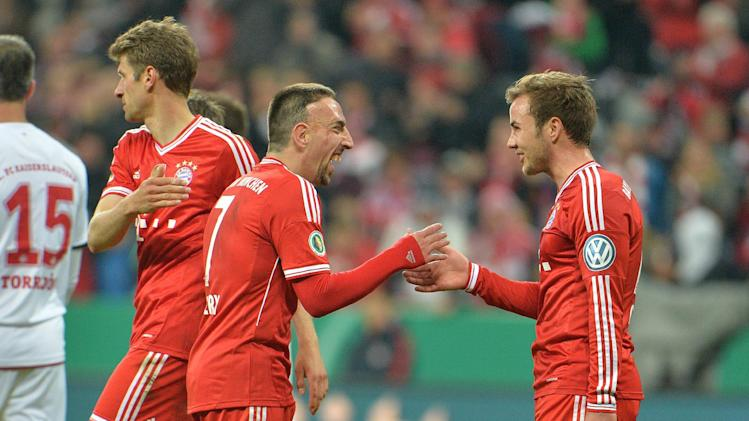 Munich's Franck Ribery of France, center, and Mario Goetze, right, celebrate after scoring during the German soccer cup (DFB Pokal) semifinal soccer match between FC Bayern Munich and FC Kaiserslautern in the Allianz Arena in Munich, Germany, on Wednesday, April 16. 2014. Bayern won 5-1