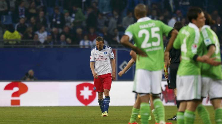 Hamburger SV's Jiracek leaves pitch as VfL Wolfsburg players celebrate after their German first division Bundesliga soccer match in Hamburg