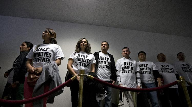 Immigration advocates gather outside the Senate Judiciary Committee in the Senate Hart Office Building on Capitol Hill in Washington, Monday, April 22, 2013, as they wait to attend a hearing on comprehensive immigration reform legislation. (AP Photo/J. Scott Applewhite)