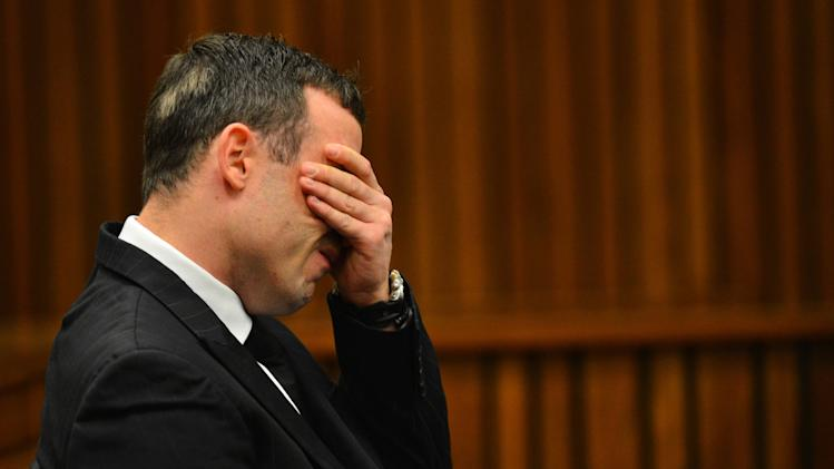 Oscar Pistorius listens to evidence in court in Pretoria, South Africa, June 30, 2014. The murder trial of Pistorius resumed Monday after one month during which mental health experts evaluated the athlete to determine if he has an anxiety disorder that could have influenced his actions on the night he killed girlfriend Reeva Steenkamp. (AP Photo/Phill Magakoe, Pool)