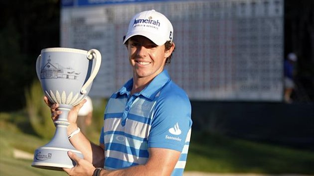 Rory McIlroy of Northern Ireland lines holds up the championship cup at the 18th hole after winning in the final round of the Deutsche Bank Championship golf tournament in Norton, Massachusetts (Reuters)