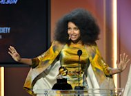 "Esperanza Spalding accepts the jazz vocal album for ""Radio Music Society"" at the 55th annual Grammy Awards on Sunday, Feb. 10, 2013, in Los Angeles. (Photo by John Shearer/Invision/AP)"