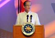 The United States pledged to help the Philippines step up its defenses in the face of a rising China as it welcomes President Benigno Aquino, seen May 4