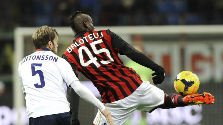 AC Milan's Mario Balotelli fights for the ball with Bologna's Mikael Antonsson during their Italian Serie A soccer match in Milan