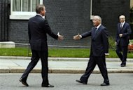 Britain's Prime Minister David Cameron (L) greets his Libyan counterpart Ali Zeidan at Number 10 Downing Street in London September 17, 2013. REUTERS/Stefan Wermuth