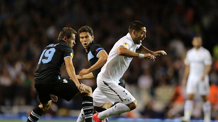 Tottenham Hotspur's Clint Dempsey gets away from Lazio's Senad Lulic