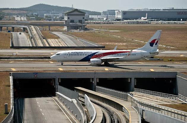 A Malaysia Airlines plane makes its way on the runway at Kuala Lumpur International Airport in Sepang on March 11, 2014