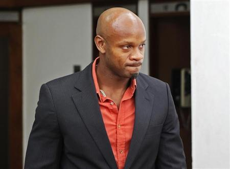 Jamaica's Olympic runner Asafa Powell takes a lunch break on the first day of his hearing before the country's anti-doping commission in Kingston