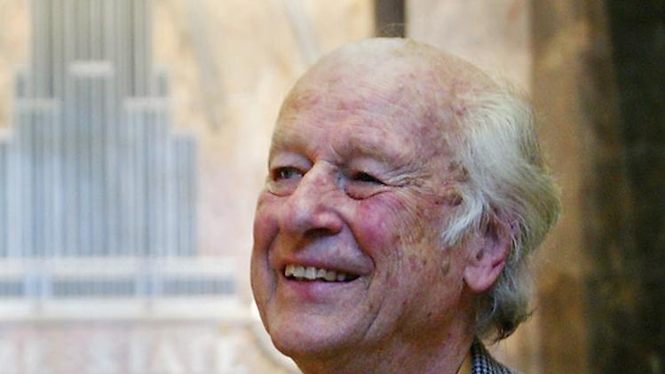 FILM - In this Saturday, May 15, 2004 file photo Ray Harryhausen visits the Empire State Building in New York. Ray Harryhausen, a special effects master whose sword-fighting skeletons, six-tentacled octopus, and other fantastical creations were adored by film lovers and admired by industry heavyweights, has died. He was 92. Biographer and longtime friend Tony Dalton confirmed that Harryhausen died Tuesday May 7, 2013 at London's Hammersmith Hospital, where the special effects titan had been receiving treatment for about a week. (AP Photo/Mike Appleton, File)