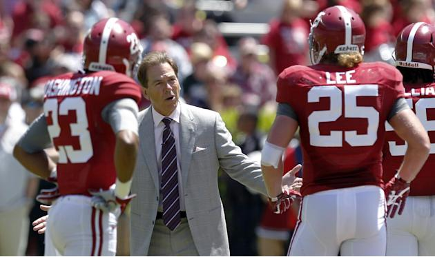 Alabama coach Nick Saban reacts to a breakdown with defensive players Alabama defensive back Jabriel Washington (23) and linebacker Dillon Lee (25) during Alabama's A-Day NCAA college football spr