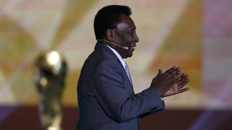 Pele claps during the draw for the 2014 World Cup in Sao Joao da Mat