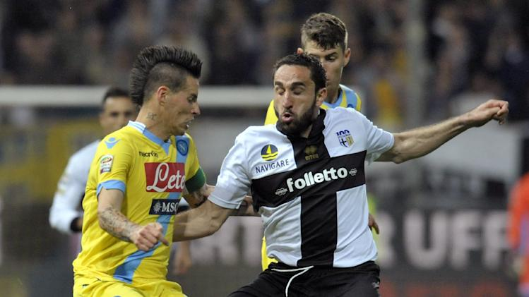 Parma's Cristian Molinaro, right, vies for the ball with Napoli's Marek Hamsik of Slovakia, during their Serie A soccer match at Parma's Tardini stadium, Italy, Sunday, April 6, 2014