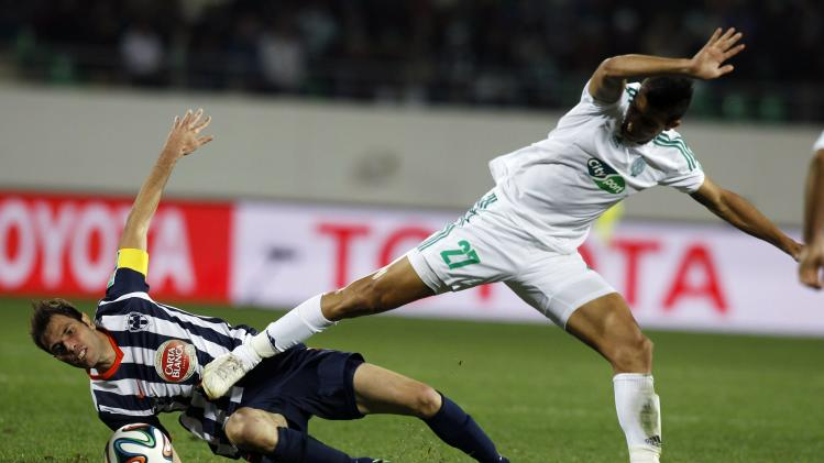 Benlamalem of Morocco's Raja Casablanca fights for the ball with Basanta of Mexico's Monterrey during their FIFA Club World Cup soccer match in Agadir