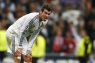 Real Madrid's Graeth Bale sticks out his tongue during their Champion's League semi-final first leg soccer match against Bayern Munich at Santiago Bernabeu stadium in Madrid, April 23, 2014. Real Madrid won the match 1-0. REUTERS/Darren Staples (SPAIN - Tags: SPORT SOCCER)