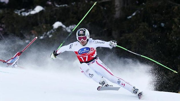 Hannes Reichelt of Austria clears a gate during the men's World Cup downhill ski race in Bormio