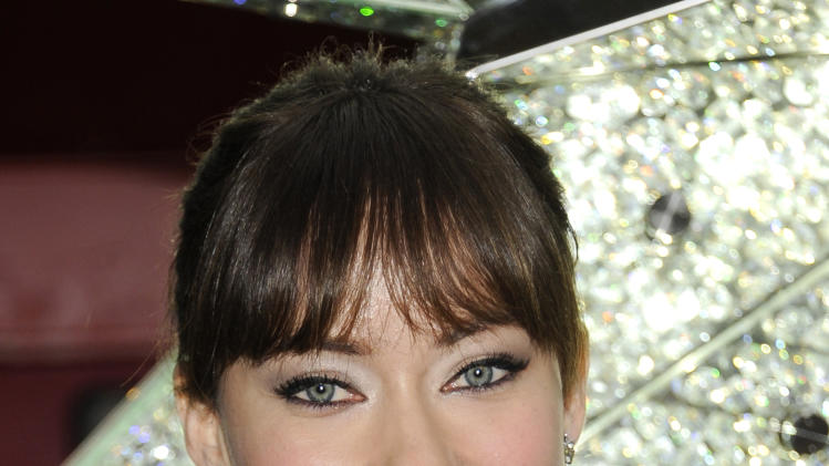Actress Olivia Wilde unveils the Swarovski Star for the 2011 Rockefeller Center Christmas Tree on Wednesday, Nov. 16, 2011 in New York. (AP Photo/Evan Agostini)
