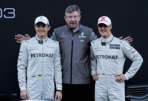 Michael Schumacher (right), Nico Rosberg (left) and team principal Ross Brawn pose