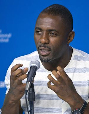 "Actor Idris Elba answers a question during the press conference for ""Mandela: Long Walk to Freedom"" at the 2013 Toronto International Film Festival in Toronto on Sunday, Sept. 8, 2013. (AP Photo/The Canadian Press, Galit Rodan)"