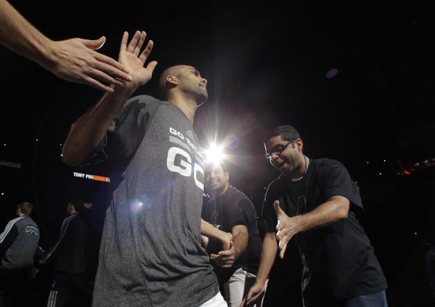 San Antonio Spurs' Tony Parker, left, of France, is introduced prior to Game 1 of the opening-round NBA basketball playoff series against the Dallas Mavericks, Sunday, April 20, 2014, in San Anton