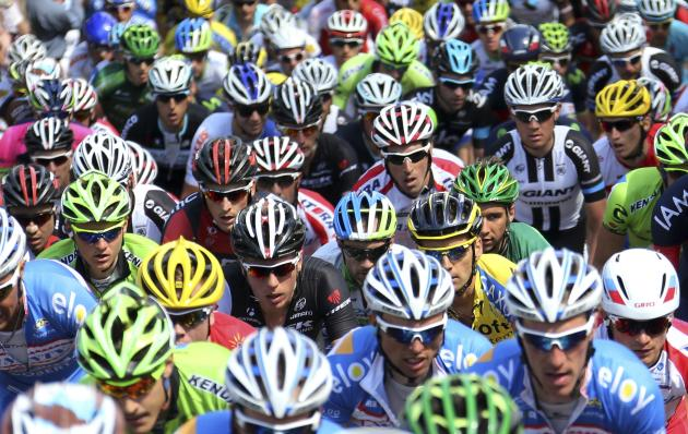 "A pack of riders climbs the ""Wall of Huy"" during the Fleche Wallonne Classic cycling race in Huy"