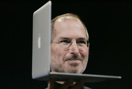 Apple CEO Steve Jobs shows the new MacBook Air during the Macworld Convention and Expo in San Francisco, California